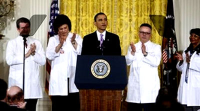 U.S. President Barack Obama shakes hands with his healthcare worker props after speaking about healthcare reform.