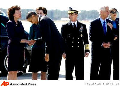 U.S. President Barack Obama bows to Tampa Mayor Pam Iorio at MacDill Air Force Base on January 28, 2010, in Tampa, Florida.   Iorio had honored CAIR annually in Tampa with its own day in November 2008, acknowledging the large amout of Muslims living in the area.