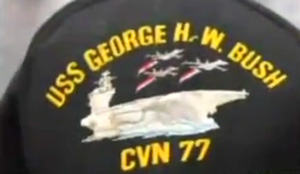 Worker fired for shirt dedicated to his son serving in the Navy.  Now Democrats are offended by an aircraft carrier serving to protect the country.